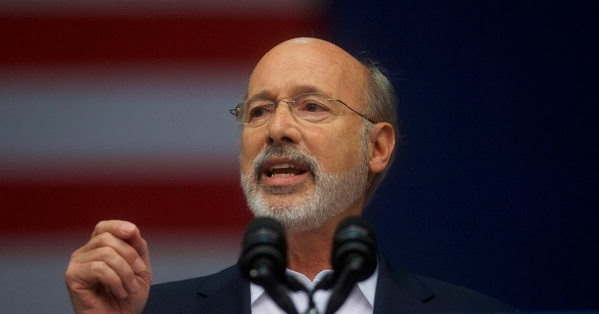 Pennsylvania Gov. Tom Wolf addresses supporters before former President Barack Obama speaks during a campaign rally for statewide Democratic candidates on Sept. 21, 2018, in Philadelphia.