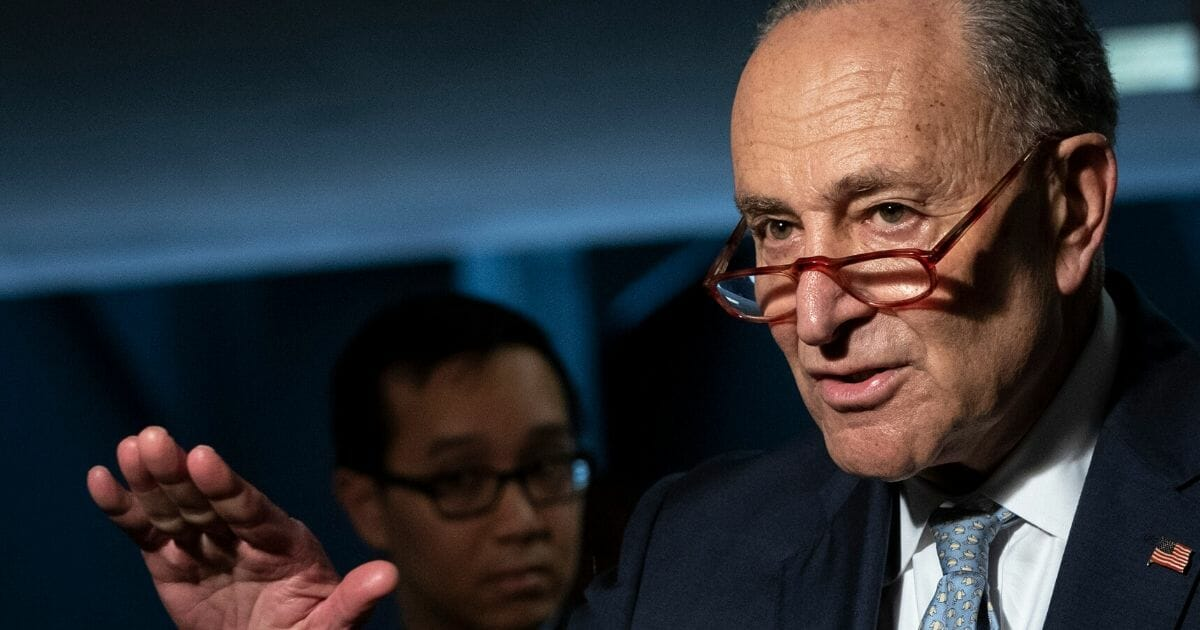 Senate Minority Leader Chuck Schumer speaks to reporters before a meeting with a select group of Senate Republicans, Senate Democrats and Trump administration officials in the Hart Senate Office Building on Capitol Hill on March 20, 2020.