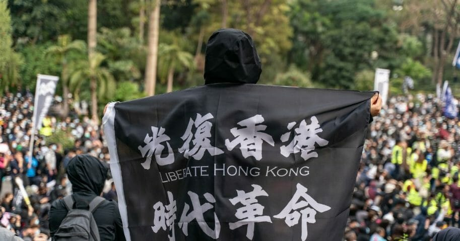 Pro-democracy protesters take part in a Universal Siege on Communists' rally at Charter Garden in Central district on Jan. 19, 2020, in Hong Kong.
