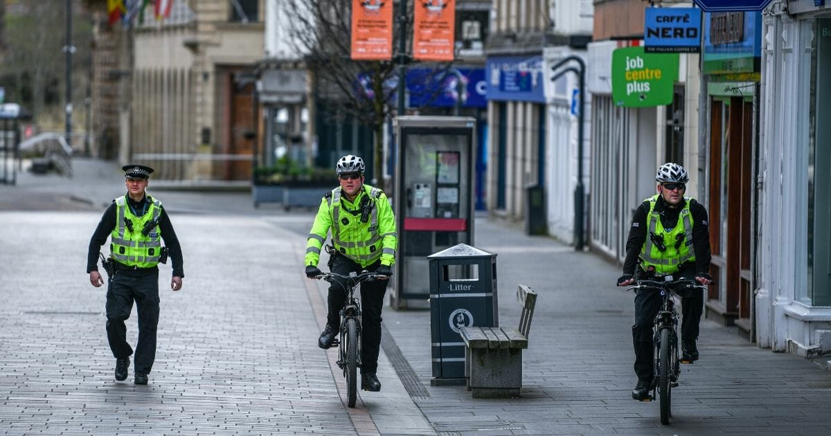 Police patrol the High Street during the coronavirus lockdown on April 3, 2020, in Perth, Scotland.