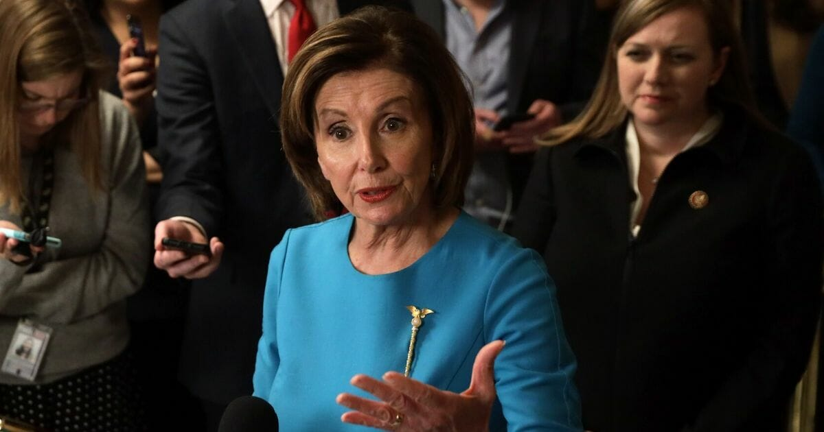 House Speaker Nancy Pelosi takes questions at a March 13 news conference at the Capitol.