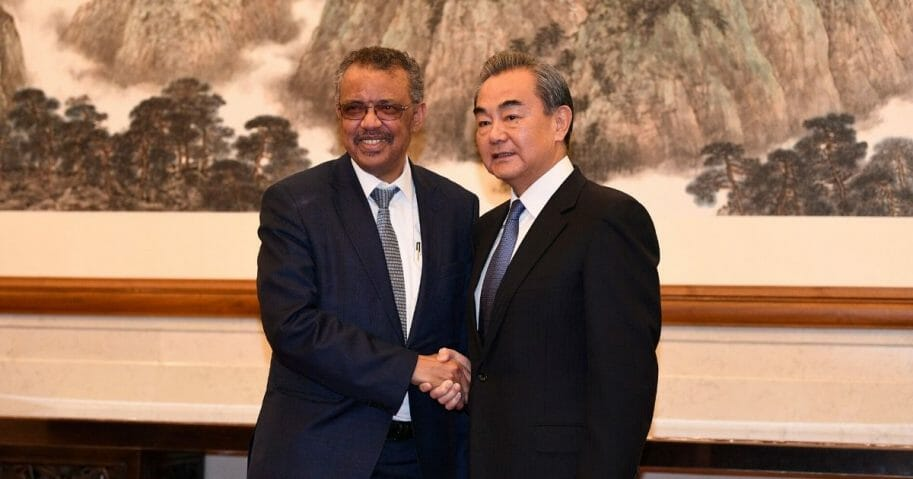 Tedros Adhanom Ghebreyesus, the director-general of the World Health Organization, poses for a photograph with Chinese President Xi Jinping before a meeting at the Great Hall of the People on Jan. 28, 2020, in Beijing.