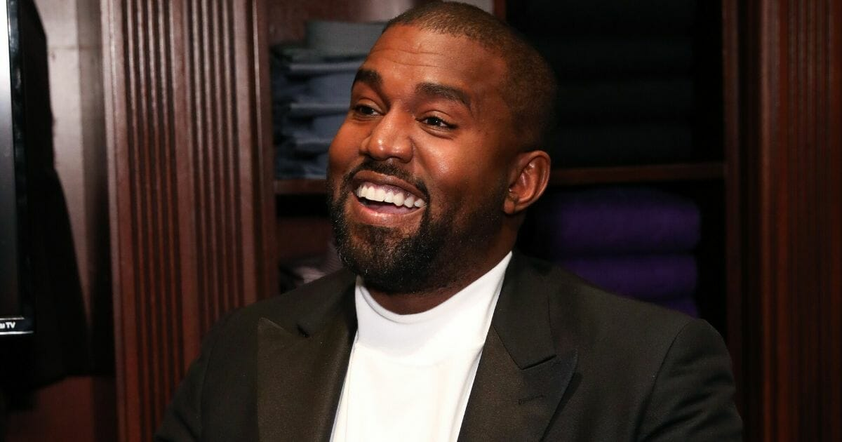 Entertainer and born-again Christian Kanye West grins in a 2019 file photo.