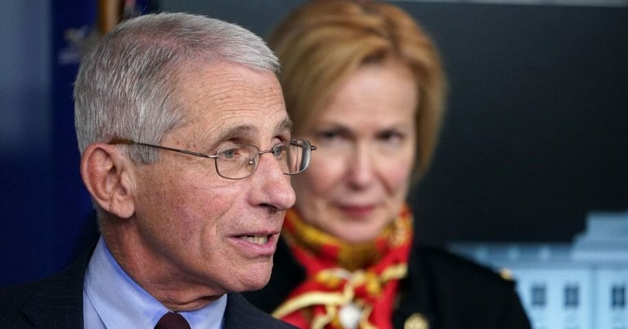 Dr. Anthony Fauci, the director of the National Institute of Allergy and Infectious Diseases, speaks as Dr. Deborah Birx, the response coordinator for White House Coronavirus Task Force, looks on during the daily briefing on the coronavirus at the White House on March 31, 2020.