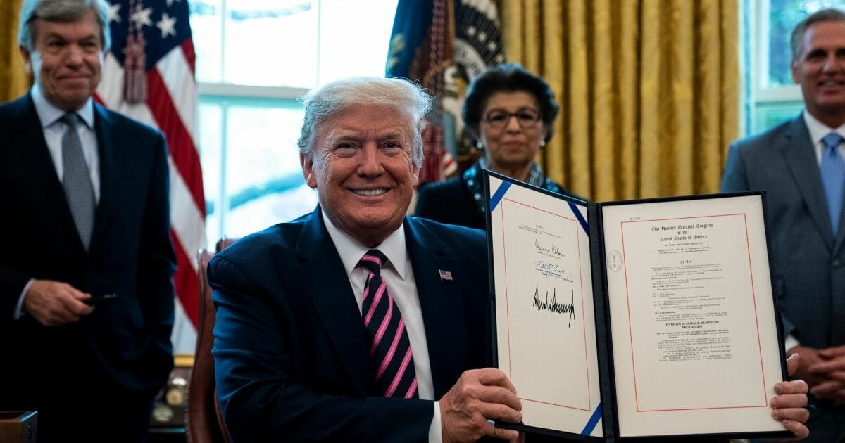 Trump Signs $484 Billion 'Phase 3.5' of Coronavirus Relief into Law