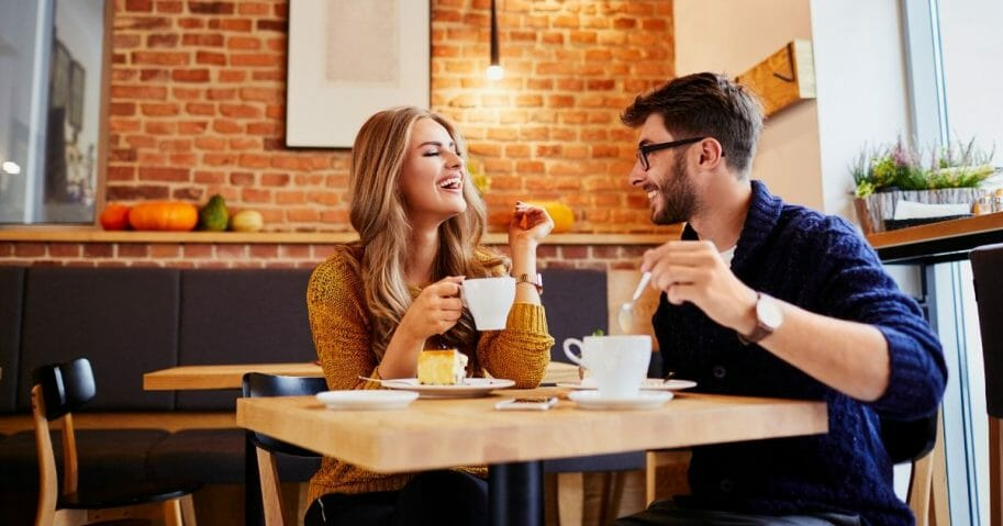 Stock image of a couple on a date in a coffee shop.