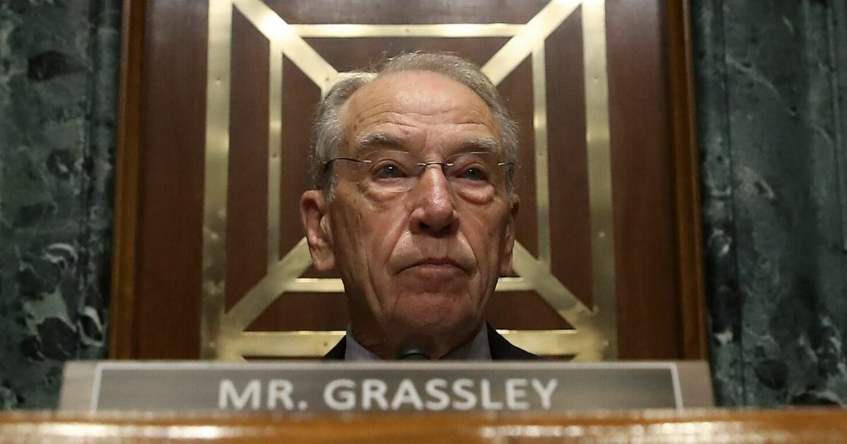 Republican Sen. Chuck Grassley of Iowa listens to testimony during a Senate Finance Committee committee hearing on Capitol Hill on Oct. 24, 2019, in Washington, D.C.