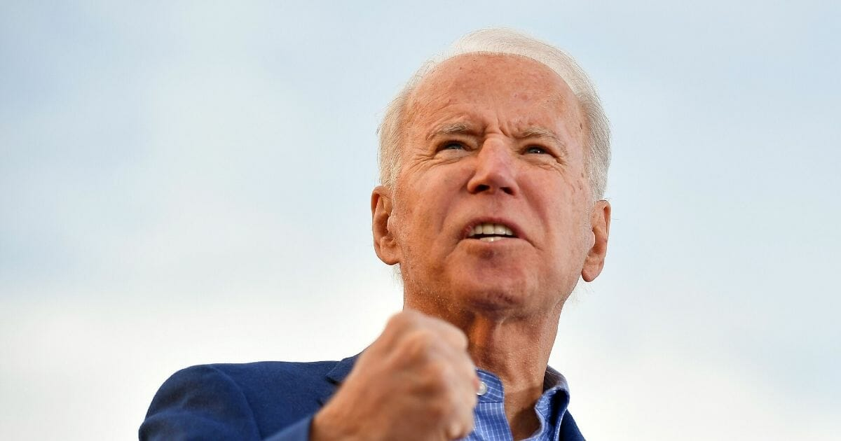 Democratic presidential candidate former Vice President Joe Biden gestures as he speaks during a campaign rally at the WWI Museum and Memorial in Kansas City, Missouri on March 7, 2020.