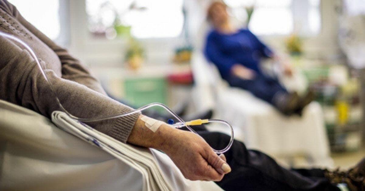 Cancer patients receive chemotherapy in the stock photo above.