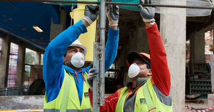 Construction workers return to work as the government ease the coronavirus work restrictions on April 14, 2020, in Madrid, Spain.