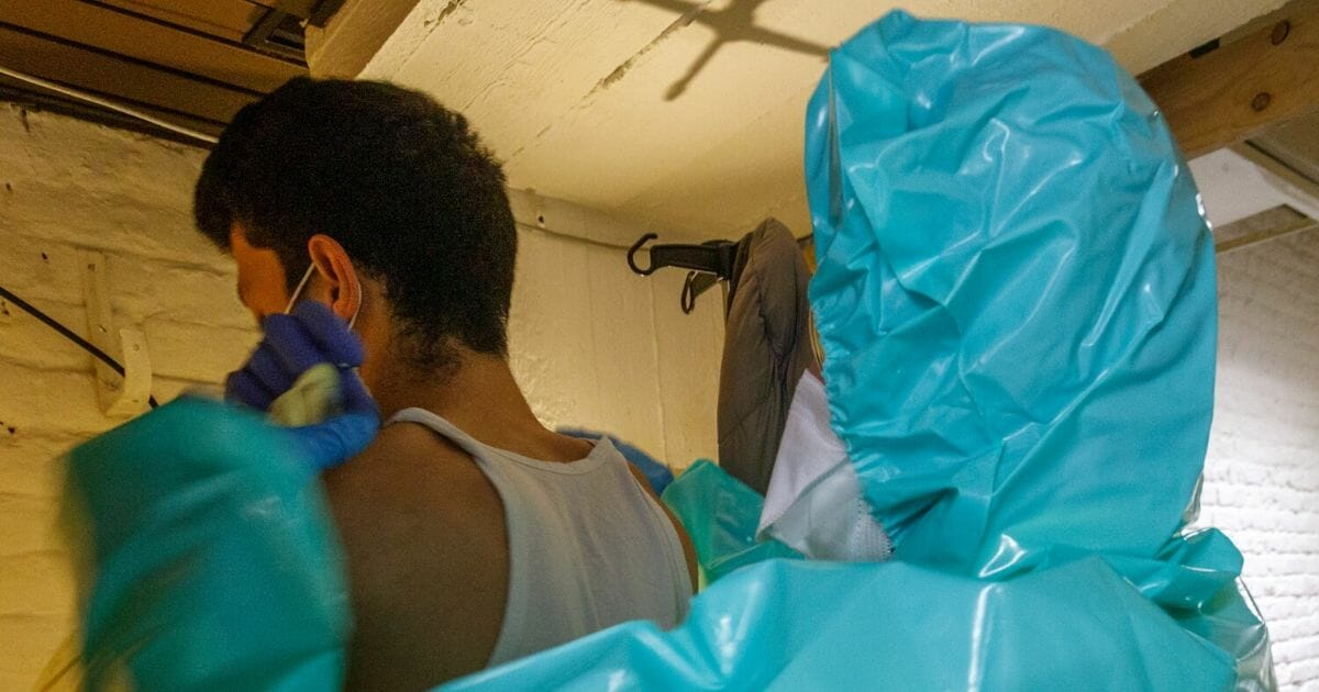 A man with coronavirus symptoms gets a sterile dressing by a paramedic in the makeshift basement of the Klinicare COVID-19 Diagnostic Center on April 2, 2020, in Brussels, Belgium.