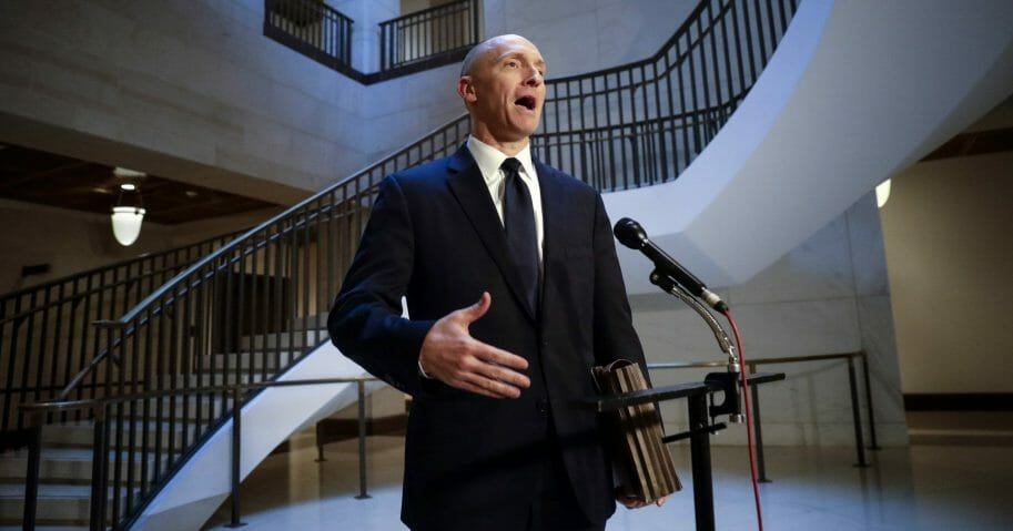 In a Nov. 2, 2017, file photo, Carter Page, a foreign policy adviser to Donald Trump's 2016 presidential campaign, speaks with reporters following a day of questions from the House Intelligence Committee, on Capitol Hill in Washington.