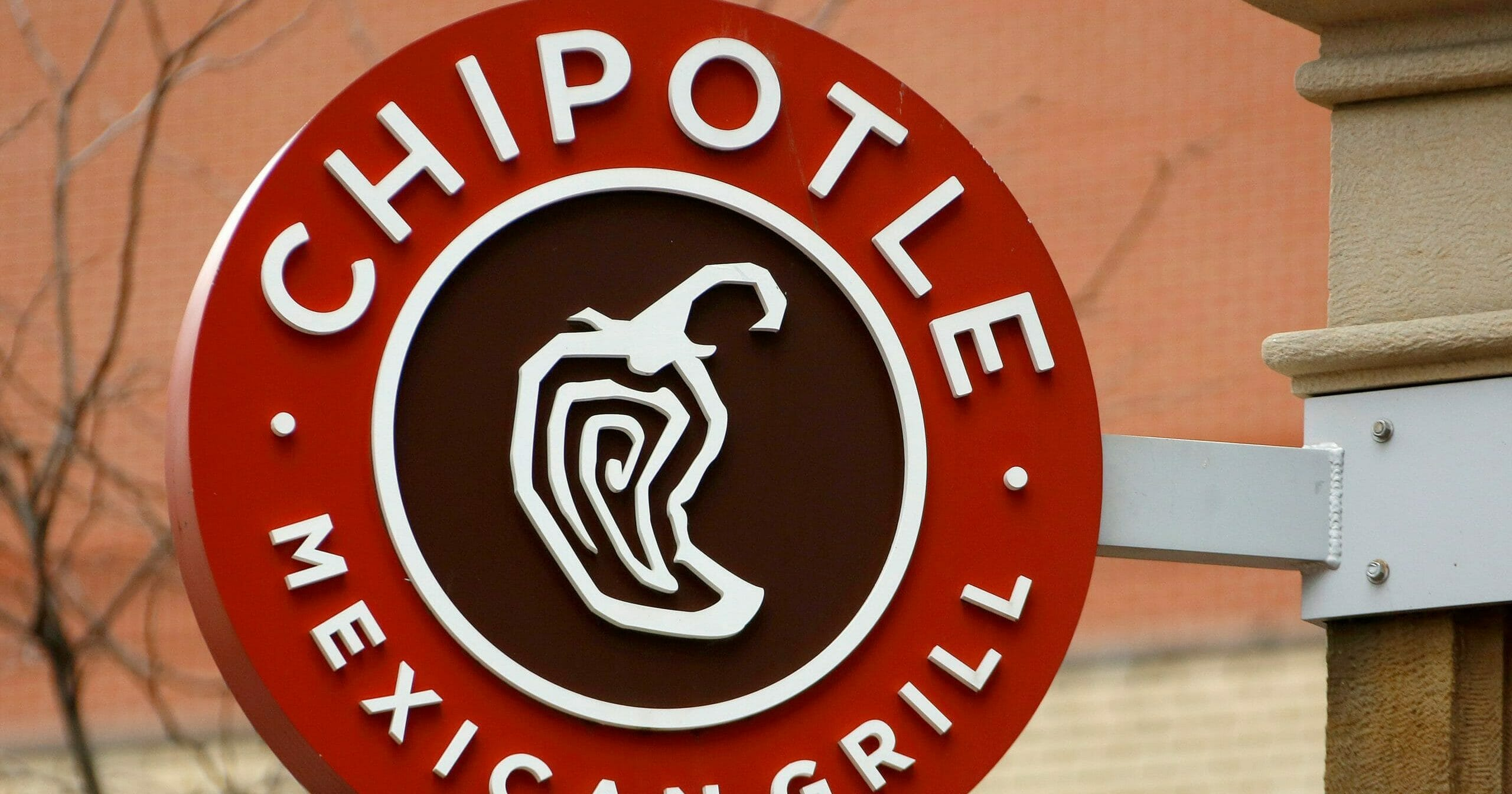 This Jan. 12, 2017, file photo shows the sign on a Chipotle restaurant in Pittsburgh.