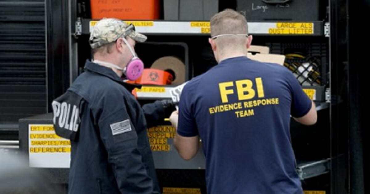 FBI agents outside the office of Allure Medical during a raid last week.