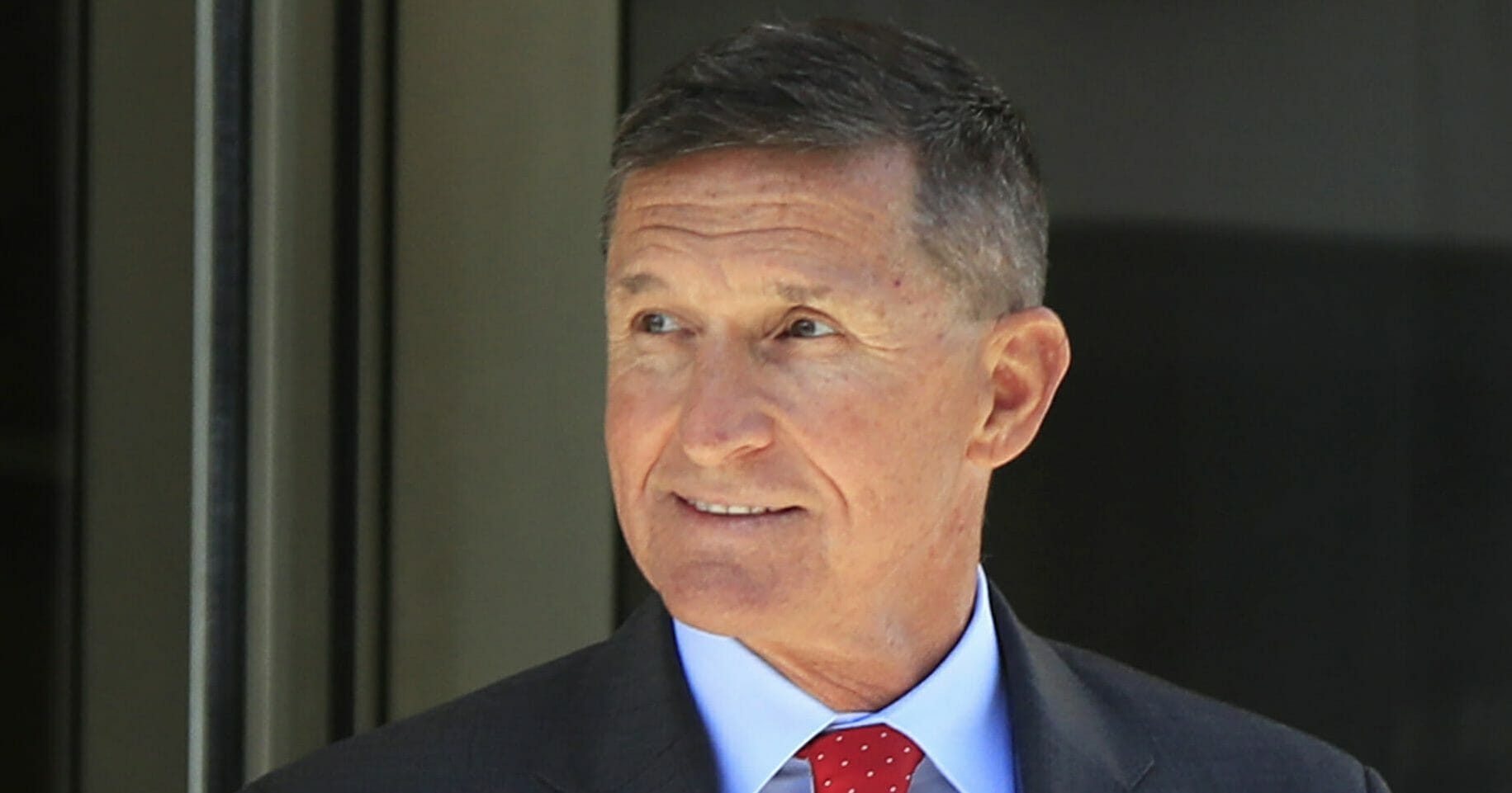 Former Trump administration National Security Adviser Michael Flynn leaves the federal courthouse in Washington July 10, 2018, following a status hearing.