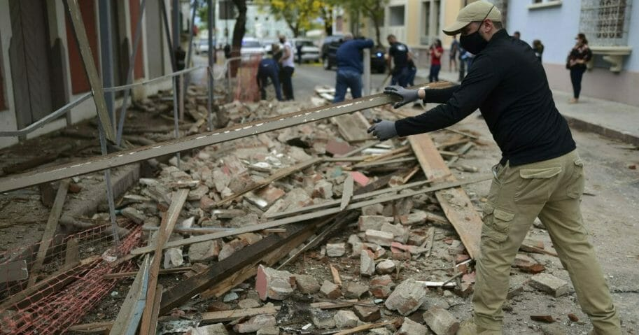 City workers remove debris caused by a 5.4-magnitude earthquake in Ponce, Puerto Rico