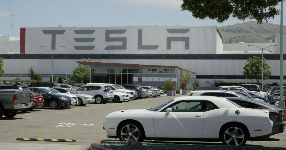 Vehicles are seen parked at the Tesla car plant on May 11, 2020, in Fremont, California.