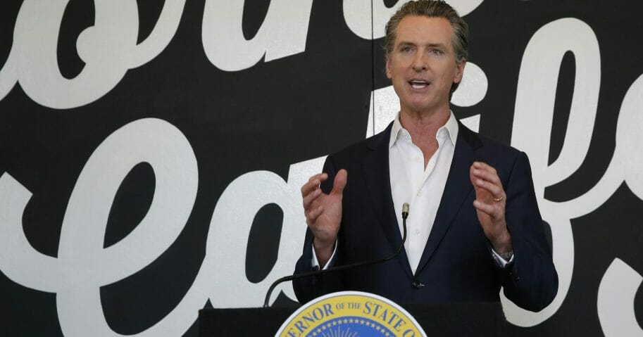 Gov. Gavin Newsom discusses his plan for the gradual reopening of California businesses during a news conference at the Display California store in Sacramento, California, on May 5, 2020.