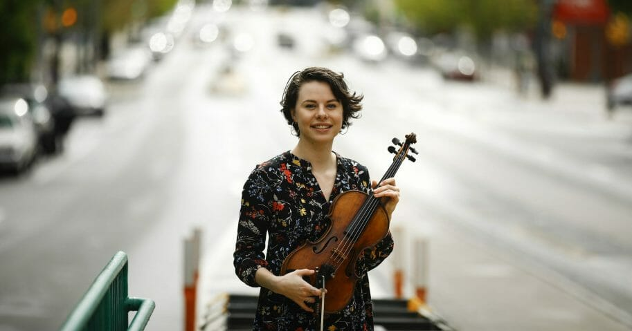 In this May 1, 2020, photo, violist Brooke Mead poses for a photograph in Philadelphia. Devastated by the cancellation of her graduate recital because of coronavirus concerns, Mead was invited to perform instead on the Philadelphia Orchestra's live webcast.