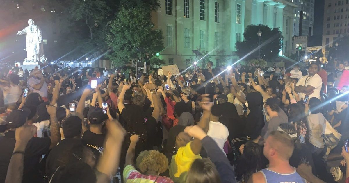 A crowd gathers Thursday, May 28, 2020, in downtown Louisville, Ky., to protest the police shooting of Breonna Taylor, a black woman killed by police in her home in March. At least seven people were shot during the protest.