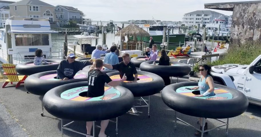 """Bumper tables,"" designed to allow people to practice social distancing while eating and talking, make their debut at Fish Tales restaurant in Ocean City, Maryland, on May 16, 2020."