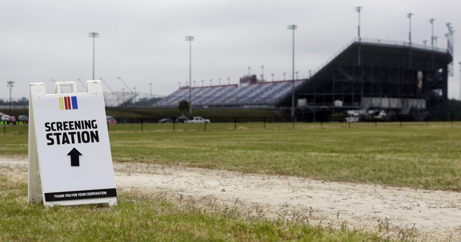 A sign directs people to a screening station outside Darlington Raceway on May 17, 2020, in Darlington, South Carolina.