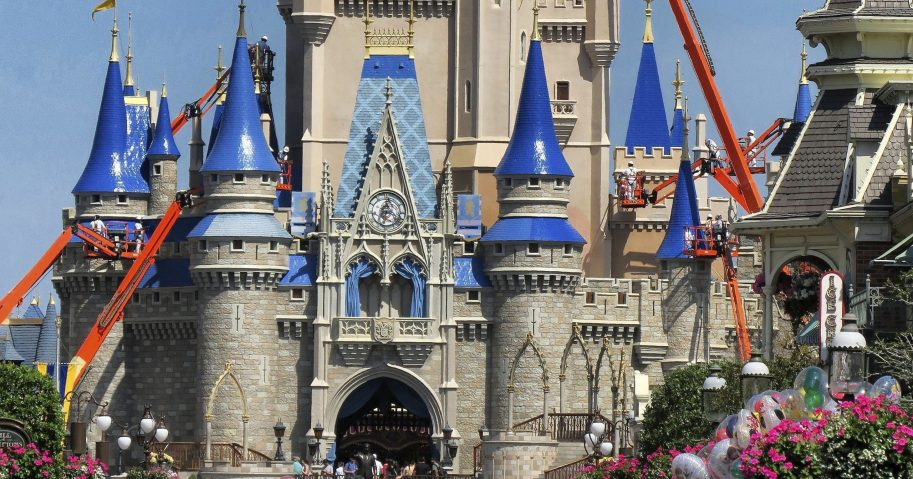 In this March 12, 2020, file photo, a crowd is shown along Main Street USA in front of Cinderella Castle in the Magic Kingdom at Walt Disney World in Lake Buena Vista, Florida.
