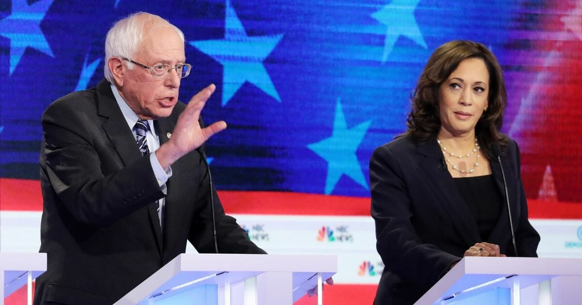 Then-Democratic presidential candidates Sen. Bernie Sanders (I-Vermont) and Sen. Kamala Harris (D-California) take part in the second night of the first Democratic presidential debate on June 27, 2019, in Miami, Florida.