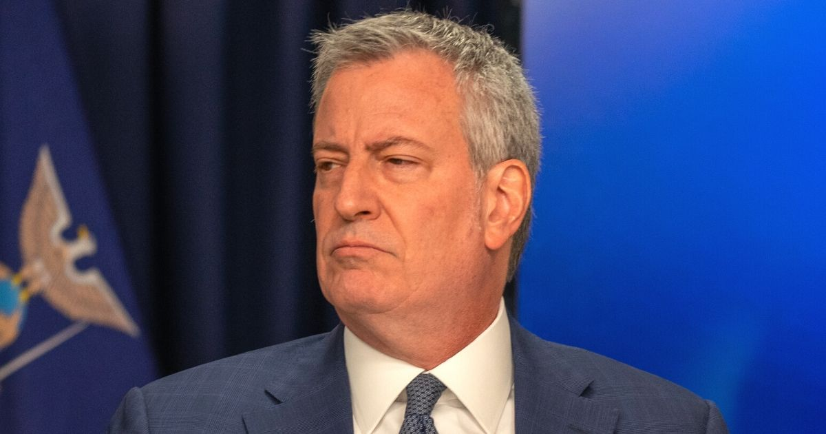 Mayor Bill de Blasio listens during a news conference about COVID-19 in New York on March 2, 2020.