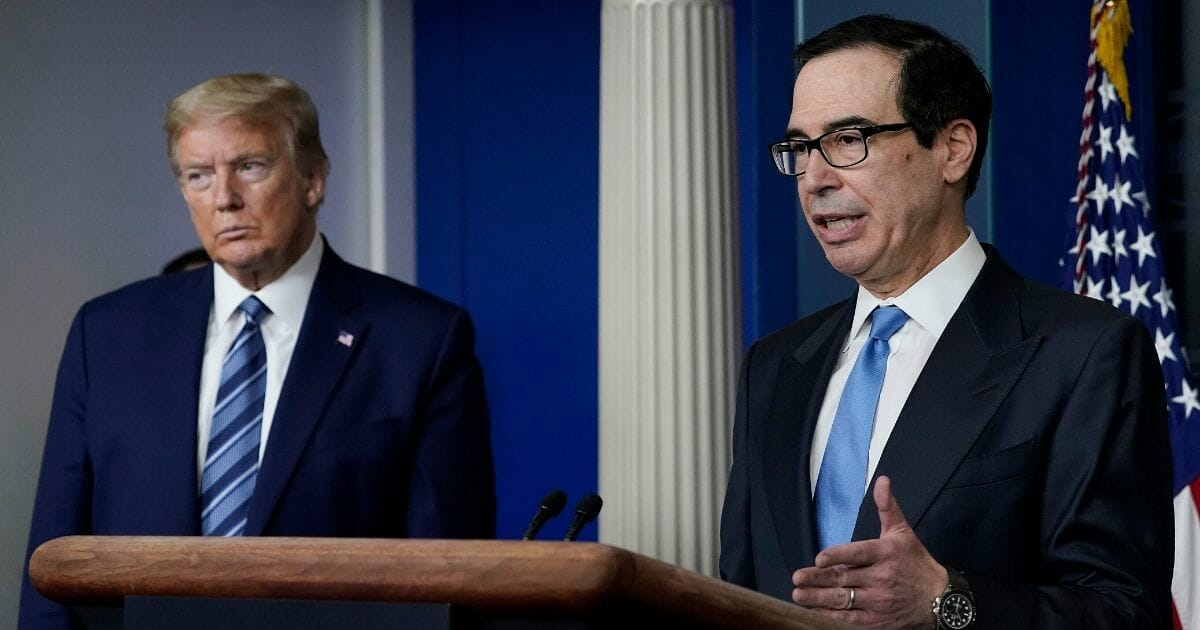 Treasury Secretary Steven Mnuchin, right, speaks as President Donald Trump looks on during the daily coronavirus task force briefing at the White House on April 21, 2020, in Washington, D.C.