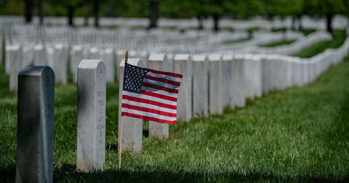 A U.S. flag is placed at a headstone in Arlington National Cemetery in Virginia on May 4, 2020.