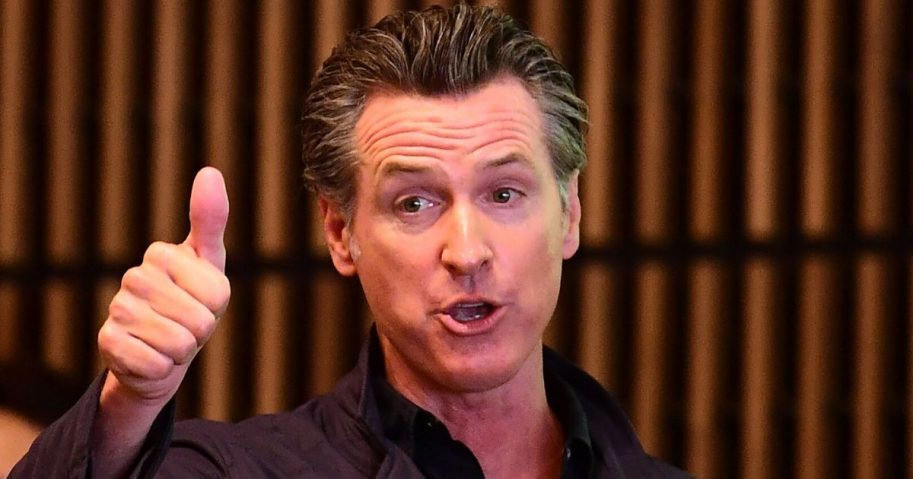 California Gov. Gavin Newsom gives a thumbs up during a visit to East Los Angeles College in Monterey Park on Aug. 29, 2019.