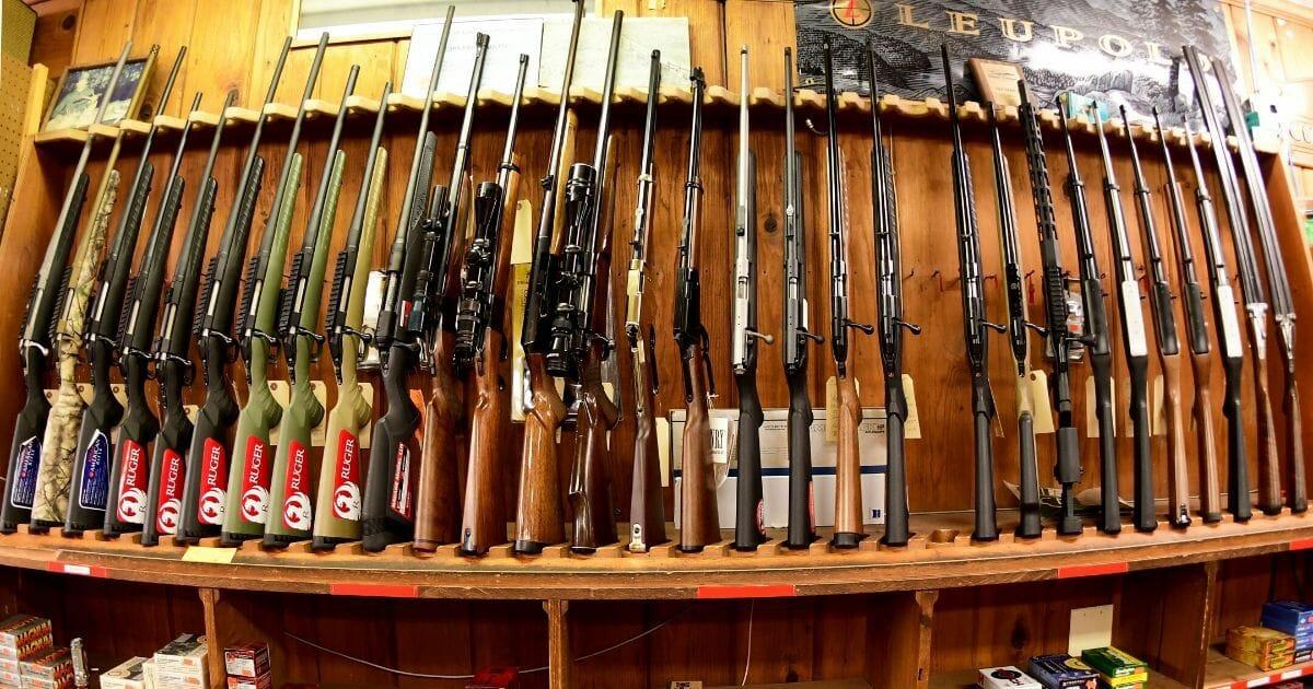 Various rifles are on display at Clark Brothers gun store in Warrenton, Virginia, on Jan. 16, 2020.