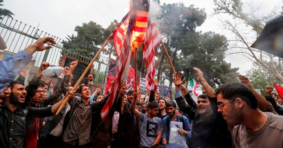 Iranians burn U.S. flags during an anti-U.S. demonstration outside the former U.S. embassy headquarters in the capital city of Tehran on May 9, 2018.