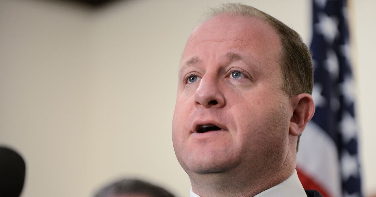 Colorado Goc. Jared Polis speaks to the media at the Douglas County Sheriffs Office Highlands Ranch Substation on May 8, 2019, in Highlands Ranch, Colorado.