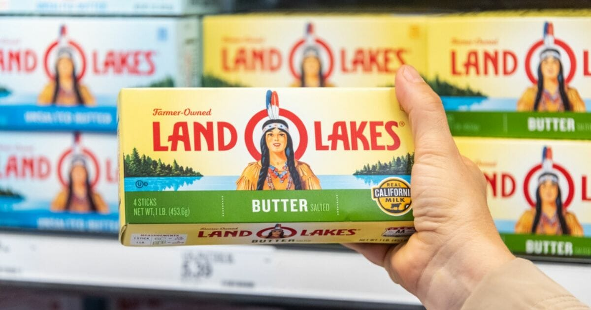 A shopper holds a package of Land O Lakes butter in a supermarket aisle in Los Angeles.
