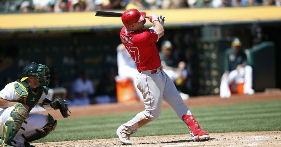 Mike Trout of the Los Angeles Angels of Anaheim hits a home run during a game against the Oakland Athletics at the Oakland-Alameda County Coliseum on Sept. 5, 2019.
