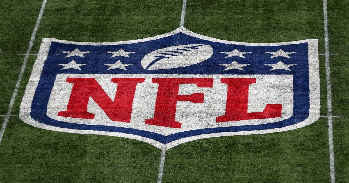 The NFL logo is seen on the field during the game between Carolina Panthers and Tampa Bay Buccaneers at Tottenham Hotspur Stadium in London on Oct. 13, 2019.