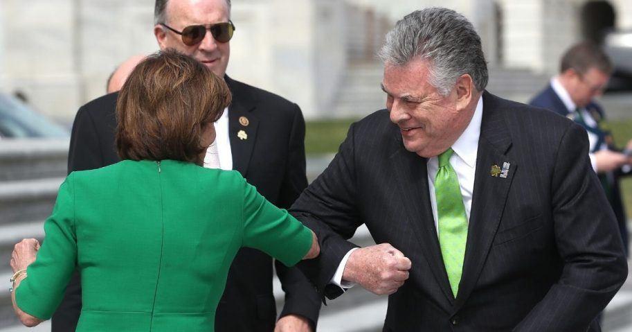 House Speaker Nancy Pelosi, D-Calif., touches elbows with Rep. Peter King, R-N.Y., after the annual Friends of Ireland luncheon at the Rayburn Room of U.S. Capitol on March 12, 2020.