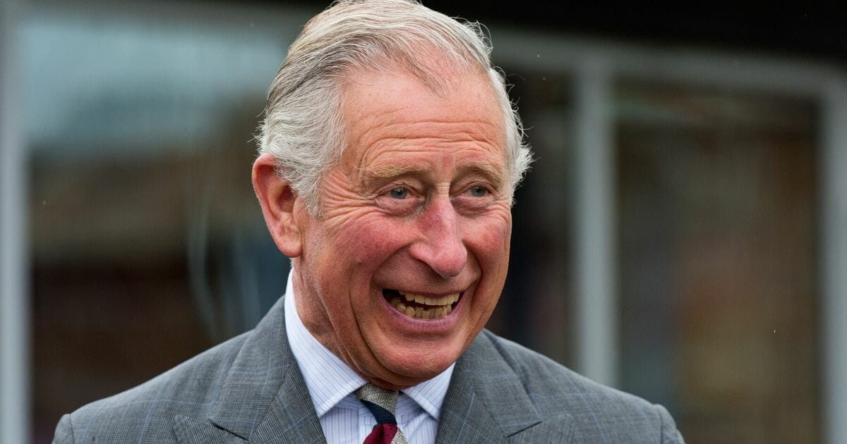 Prince Charles, Prince of Wales, meets residents of The Guinness Partnership's 250th affordable home in Poundbury on May 8, 2015, in Dorchester, Dorset.