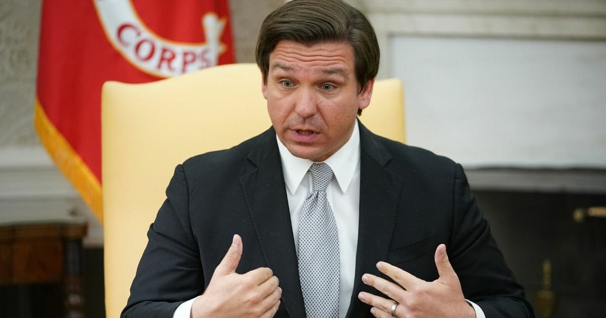 Florida Gov. Ron DeSantis speaks during a meeting with President Donald Trump in the Oval Office of the White House on April 28, 2020.