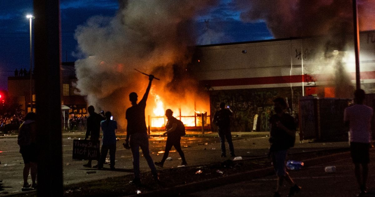 A fire burns inside of an AutoZone store near the 3rd Police Precinct on May 27, 2020, in Minneapolis.