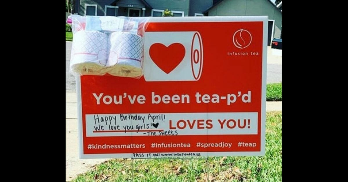 Infusion Tea sign on lawn