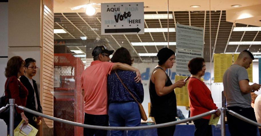 Texas voters wait in line to cast their ballots