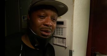Small business owner K.B. Balla weeps over his business, destroyed during this week's Minneapolis riots.