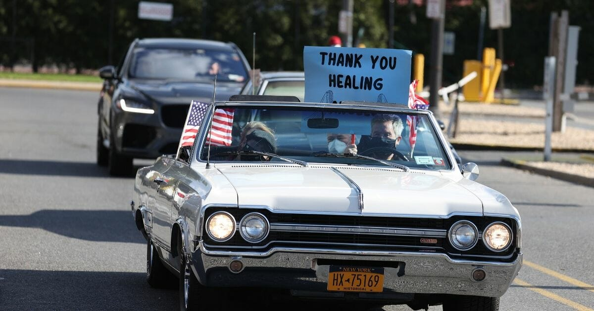 A parade of classic cars salutes health care workers outside Nassau University Medical Center in East Meadow, New York, on May 4.