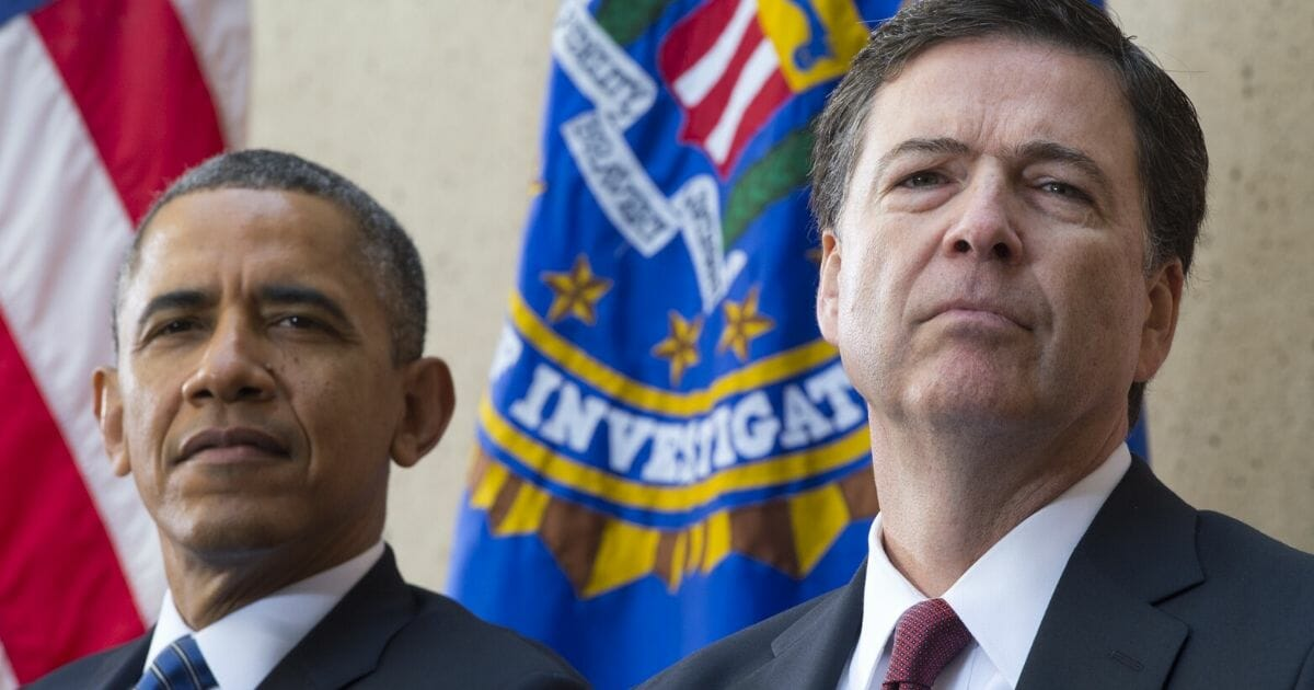 Then-President Barack Obama sits alongside then-newly sworn-in FBI Director James Comey during an installation ceremony at the FBI headquarters in Washington in 2013.
