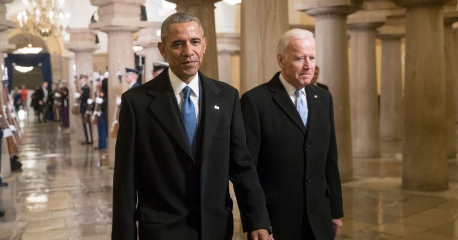 Then-President Barack Obama and then-Vice President Joe Biden walk through the Crypt of the Capitol for Donald Trump's inauguration ceremony in Washington, D.C., on Jan. 20, 2017.
