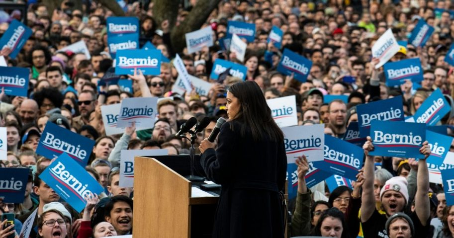 Democratic Rep. Alexandria Ocasio-Cortez of New York addresses supporters during a campaign rally for Democratic Sen. Bernie Sanders of Vermont, then a presidential candidate, on March 8, 2020, in Ann Arbor, Michigan.