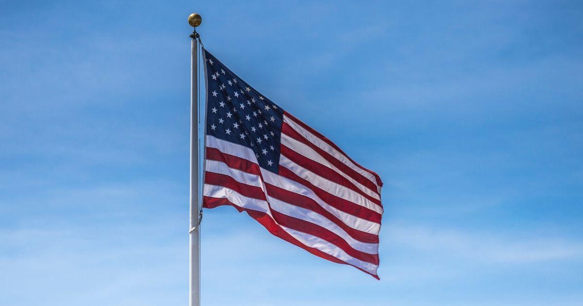 An American flag against a blue sky.